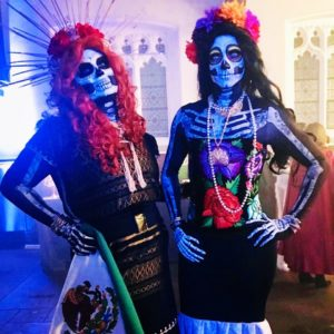 Two members of  Catrinas Corazón dressed as traditional Day of the Dead skeltons. (Photo:  Catrinas Corazón)