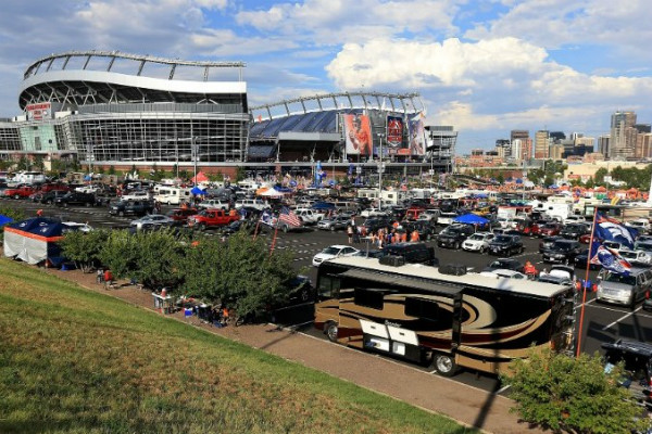 Cars and RVs parked outside a football stadium. (Photo: Getty Images)