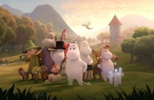 Characters from the animated show Moominvalley standing in a meadow outside a castle. (Photo: Gutsy Animation)