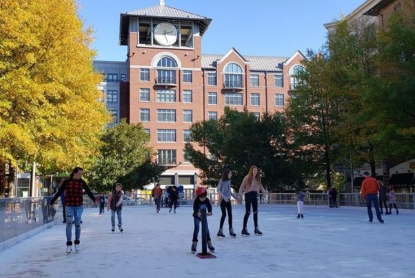People ice skaring at the Rockville Town Square Outdoor Ice Rink with leaves still on the trees. (Photo: Rockville Town Square Outdoor Ice Skating)