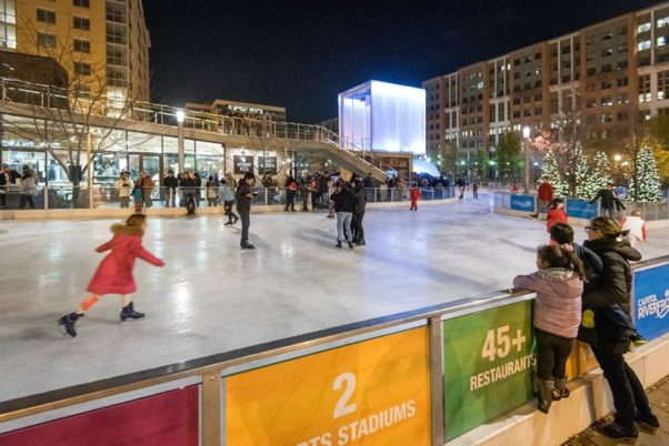 People skating in Canal Park in front of Wiseguy Pizza. (Photo: Canal Park Ice Rink)