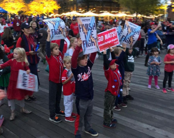Fans holdng up signs at a World Series watch party last weekend at Yards Park. (Photo: Capital Riverfront)