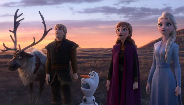 Sven, Kristoff, Olaf, Anna and Elsa standing in a grassy field looking up at something outside the picture. (Photo; Walt Disney Studios)