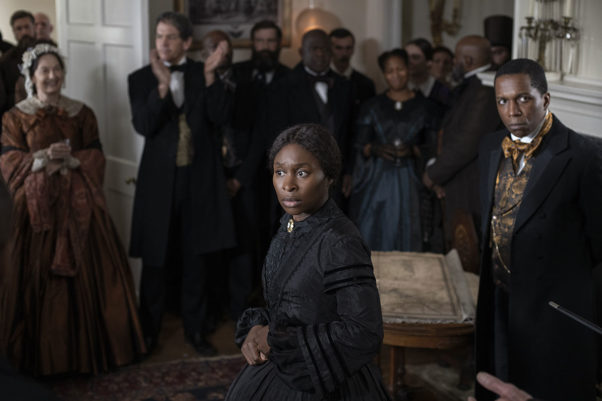 Harriet Tubman (Cynthia Erivo) and William Still (Leslie Odom Jr.) dressed in formal clothes at a party. (Photo: Focus Features)