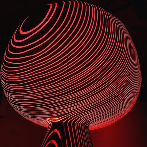 An inflatable display that looks like a hot air balloon wrapped in red lights. (Photo: ENESS)