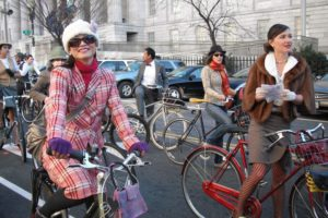 Men and women dressed in tweed on bikes during a previous Tweed Ride. (Photo: Ken Mayer/Flickr)