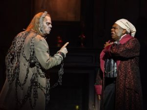 The ghost of Jacob Marley (Stephen F. Smith) visits Ebenezer Scrooge (Craig Wallace). (Photo: Scott Suchman)