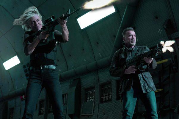Sarah Connor (Linda Hamilton) and T-800 ( Arnold Schwarzenegger) fire guns. (Photo: Paramount Pictures)