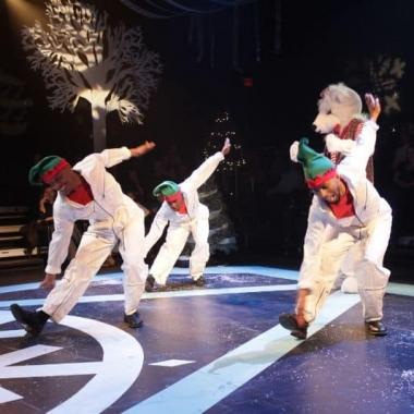 Dancers dressend as elves perform with a life-size polar bear. (Photo: Step Afrika!)