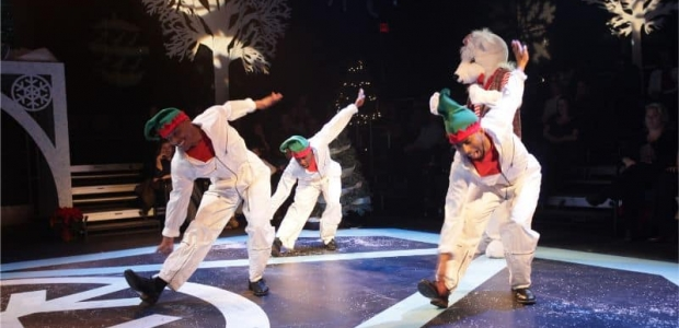 Dancers dressend as elves perform with a life-size polar bear. (Photo: Step Afrika!)