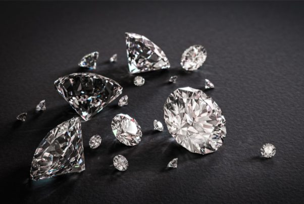 Several shiny diamonds scattered on a black background. (Photo: PIxers)