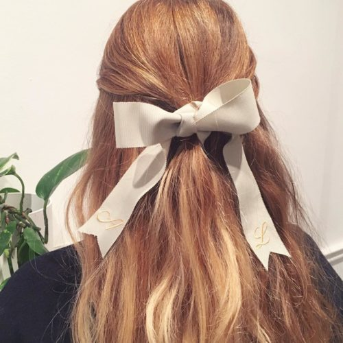 Blonde woman from behind with a white ribbon in her hair. (Photo: Amy Lawrenson/Instagram)
