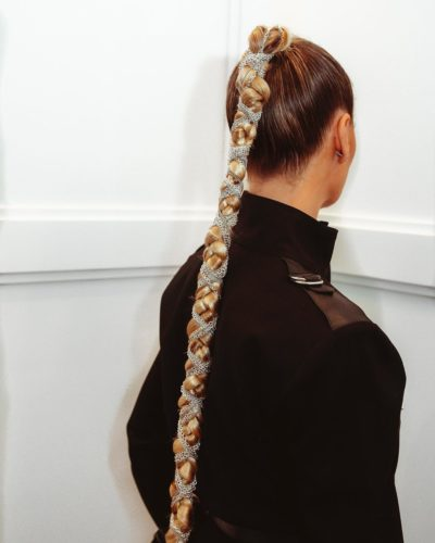 woman from behind with a chain wrapped in her ponytail. (Photo: Justine Marjan/Instagram)