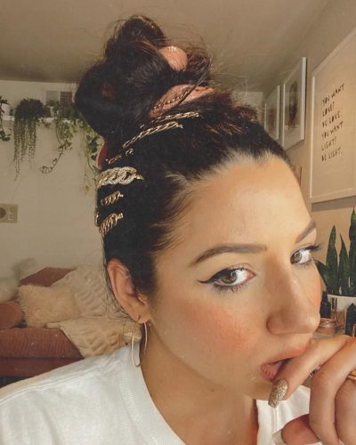 Woman with hair in a bun wth clips around the base of the bun. (Photo: Justine Marjan/Instagram)