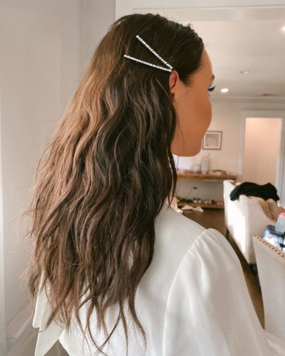 A woman from behind with decorative pins in her hair. (Photo: Justine Marjan/Instagram)