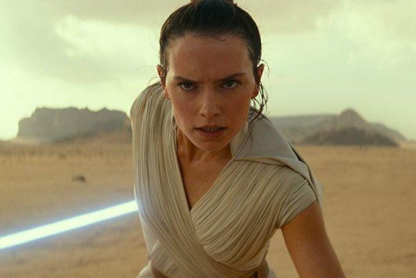 Rey (Daisy Ridley) ready to battle with her light saber drawn. (Photo: Walt Disney Studios)