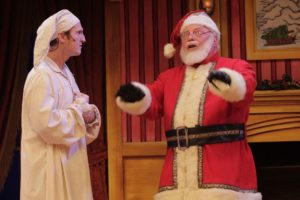 A man in his nightcap and night shirt gets a visit from Santa. (Photo: Virginia Repertory Theatre)