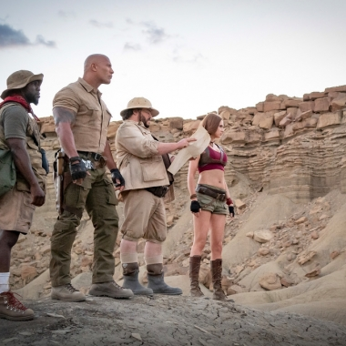 Kevin Hart, Dwayne Johnson, Jack Black and Karen Gillan standing in the dessert looking to the right. (Photo: Sony Pictures)