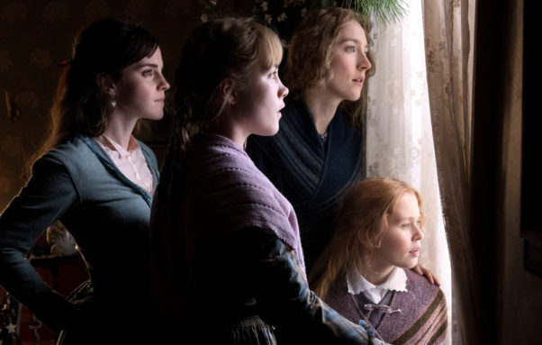 Meg March (Emma Watson), Amy March (Florence Pugh), Jo March (Saoirse Ronan) and Beth March (Eliza Scanlen) look out a window. (Photo: Sony Pictures)