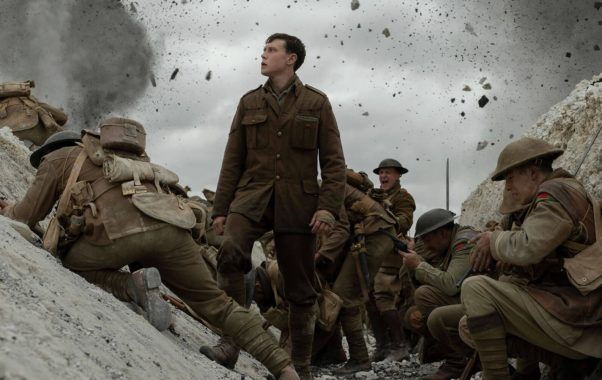 Lance Corporal Schofield (George MacKay) stand in the middle of battle. (Photo: Universal Pictures)