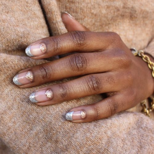 Woman with the tips of her nails in silver glitter and her nail beds in gold glitter. (Photo: Paintbox/Instagram)