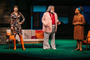 Mrs. Page (Regina Aquino, left) and Mrs. Ford (Ami Brabson, right), Windsor's merry wives, having fun retaliating against a conniving Falstaff (Brian Mani, center). (Photo: Cameron Whitman Photography)