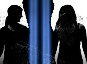photo of two women's sillouettes divided by the blue lights rising from the World Trade Center. (Photo: Prologue Theatre)