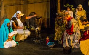 The three kings place gifts in front of Mary, Josephy and the baby as an angel, shepherd and real donkey look on. (Photo: Gala Hispanic Theatre)