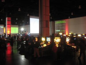 A room full of people playing arcade video games. (Photo: Super MAGFest)