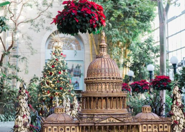 A miniture display of the U.S. Capitol with a pointesttia and Christmas tree int he background. (Photo: abroadwife/Instagram)