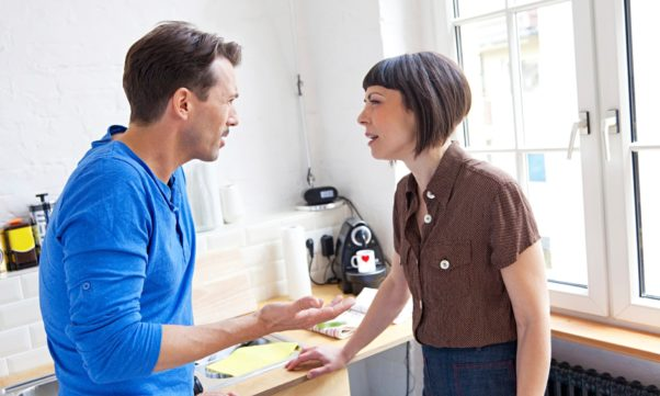 A white couple arguing in the kitchen. (Photo: Getty Images)