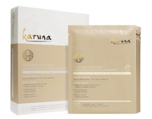 Four packets of Karuna Hydrating+ Hand Mask beside the box they came in. (Photo: Karuna)