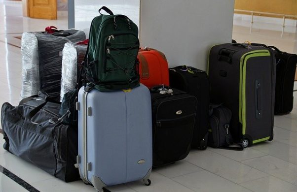 Several suitcases and a backpack all sitting together. (Photo: Iva Bu;k/Pixabay)