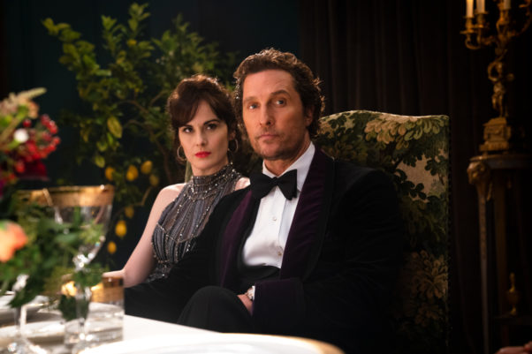 Rosalind (ichelle Dockery, left) and MIckey Pearson (Matthew McConaughey) at dinner in an evening gown and tux. (Photo: STX Entertainment)