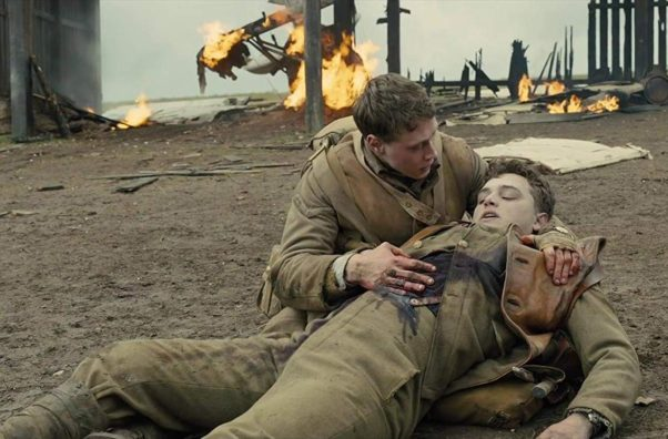 ance Corporal Schofield (Lance MacKay) holds a dying Lance Corporal Blake (Dean-Charles Chapman) on the battlefield. (Photo: Universal Pictures)