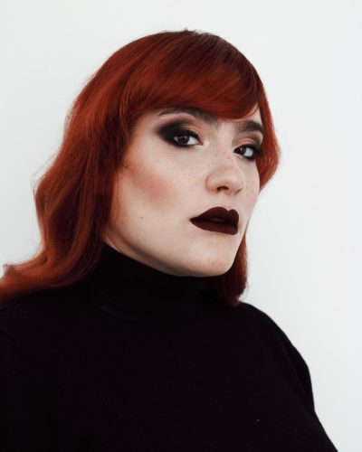 Red headed woman with smokey eyes and very dark red lips. (Photo: Ana Pizarro/Instagram)