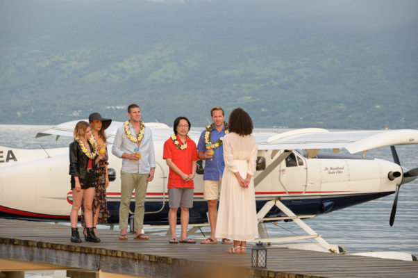 Melanie Cole (Lucy Hale, l to r), Gwen Olsen (Maggie Q), Patrick Sullivan (Austin Stowell), Brax Weaver (Jimmy O. Yang) and J.D. Weaver (Ryan Hansen) are greeted by Julia (Parisia Fitz-Henley) as they arrive on Fantasy Island. (Photo: Sony Pictures)