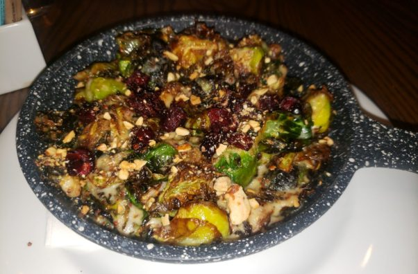 Brussels sprouts served with cranberries, almonds, mustard and bechamel in a small skillet. (Photo: Mark Heckathorn/DC on Heels)