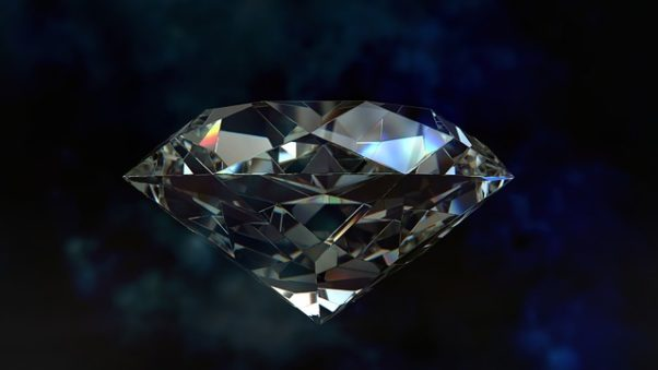 A side view of a diamond on a blue background. (Photo: Dimitris Christou/Pixabay)