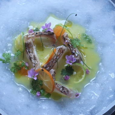 Torched red snapper, in chilled citrus dashi with shirasu, spring onion, mandarins and limes. (Photo: Mark Heckathorn/DC on Heels)