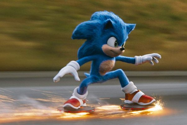 Sonice the Hedgehog racing down the road with sparks coming from his shoes. (Photo: Paramount Pictures)