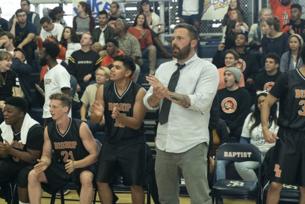 Jack Cunningham (Ben Affleck) dressed in shirt and tie coaches his high school basketball team from the bench during a game. (Photo: Warner Bros. Pictures)