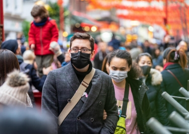 People wearing a face masks to protect themselves from COVID-19 in London. (Photo: iStock)