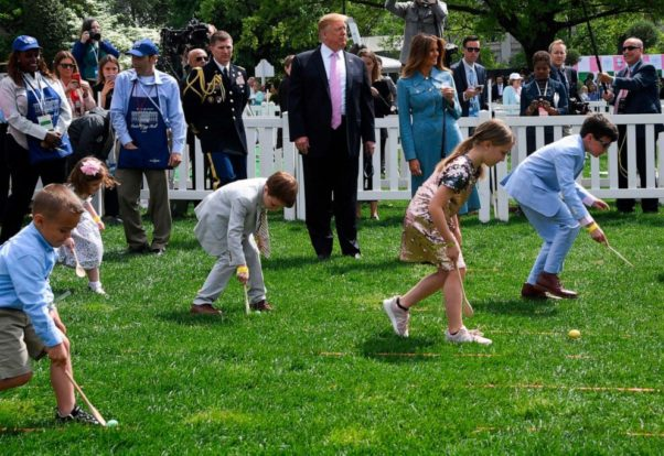 Children roll Easter eggs on the south lawn of the White House in 2019 as President and Melania Trump watch. (Photo: Getty Images)