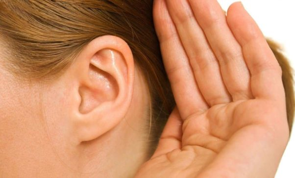 Woman cupping her hand to her ear. (Photo: 123rf)