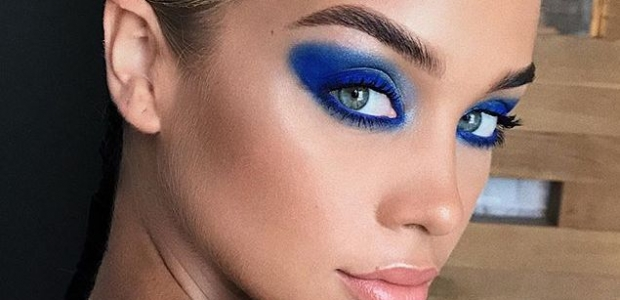 woman with bold, blue eyeshadow on. (Photo: Hung Vanngo/Instagram)