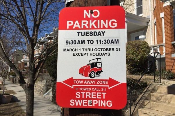 No Parking Street Sweeping sign indicationg no parking from 9:30-11:30 a.m. Tuesday. (Photo: Petworth News)