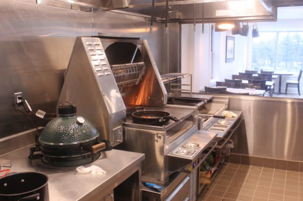 Xiquet's glass-enclosed kitchen features a wood-fired Green Egg smoker (l to r), rotisserie and plancha. (Photo: Mark Heckathorn/DC on Heels)