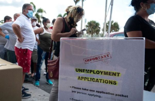 People wait in line to receive the printed Unemployment Benefits application in the parking lot of Kennedy Library in Hialeah, Fla. (Photo: Cristobal Herrera/EPA-EFE/Shutterstock)