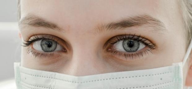 Closeup of a woman's eyes wearing a surigal mask. (Photo: Ani kolleshi/Unsplash)